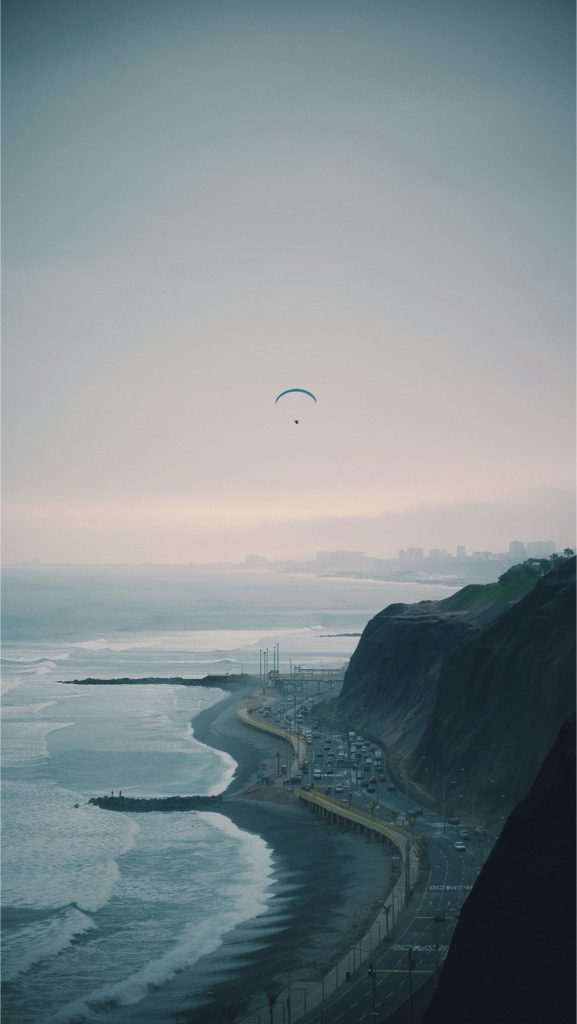 paraglide sailing over the coast